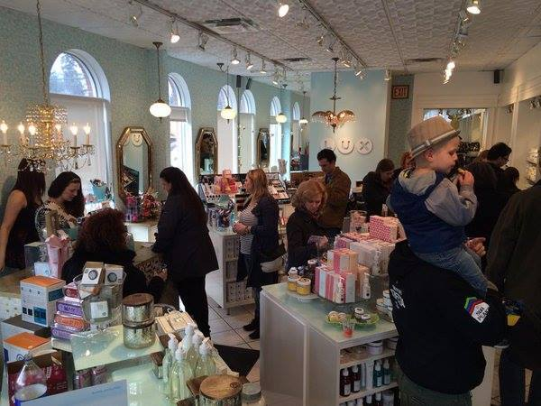 Cash mobbers inside Lux Beauty Boutique on High Street at a previous Cash Mob Edmonton event.